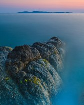 Submerged Roch On Mykonos Island, Greece