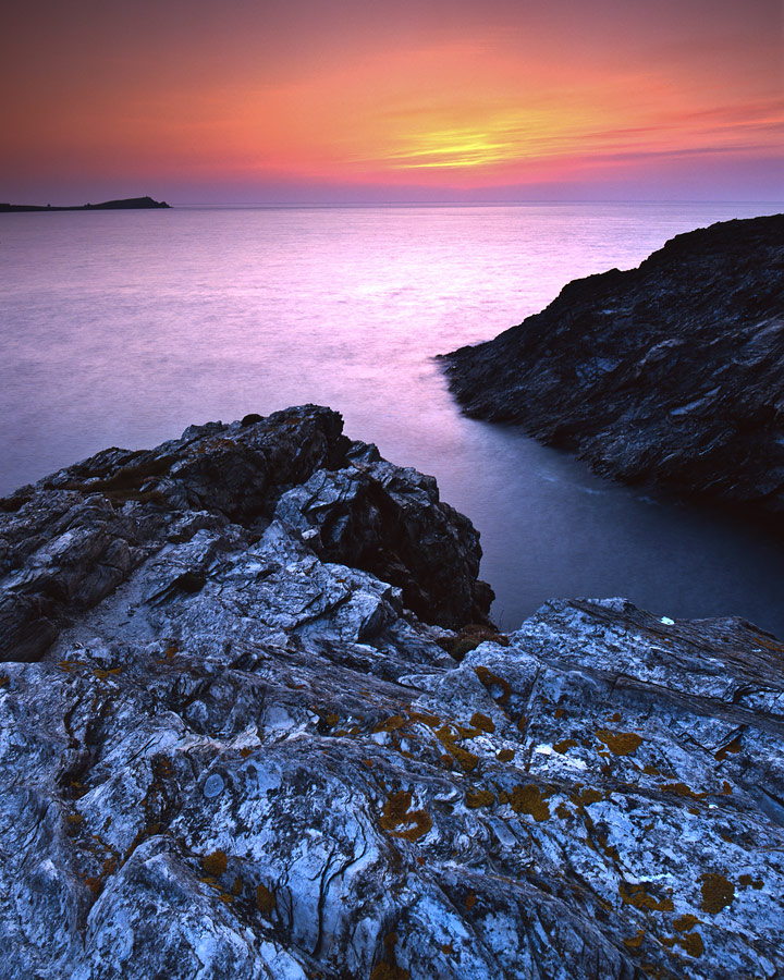 Sunset By The Cliffs Of Newquay In Cornwall England