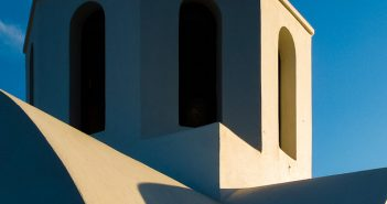 Contrast. Greek Orthodox chapel on Santorini island, Greece